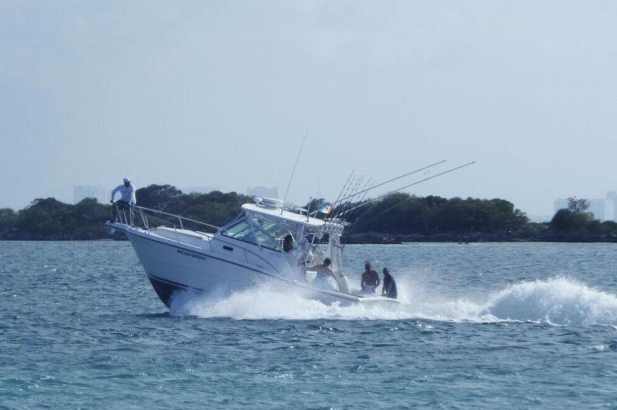 Golf cart rental isla mujeres sport fishing for Isla mujeres fishing